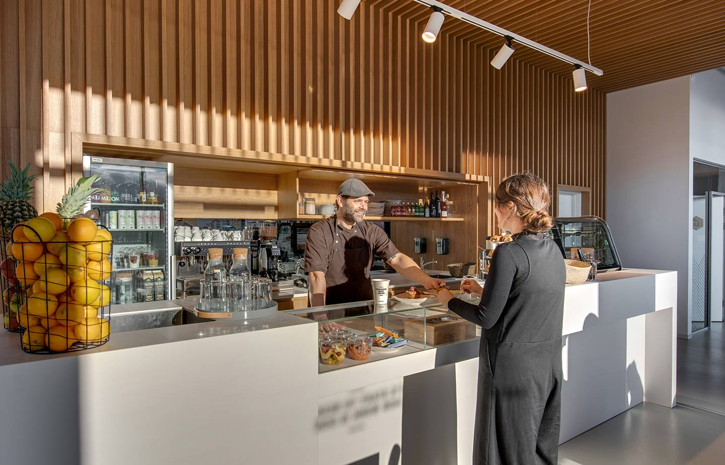 coffee bar with a woman ordering coffee from a man