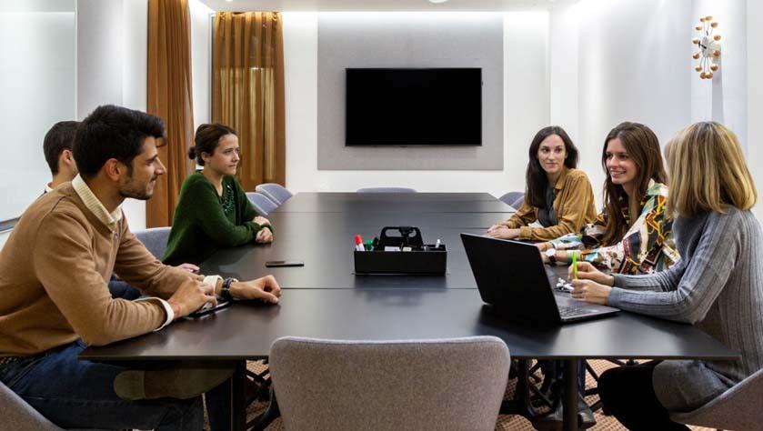 people working in a designer meeting room