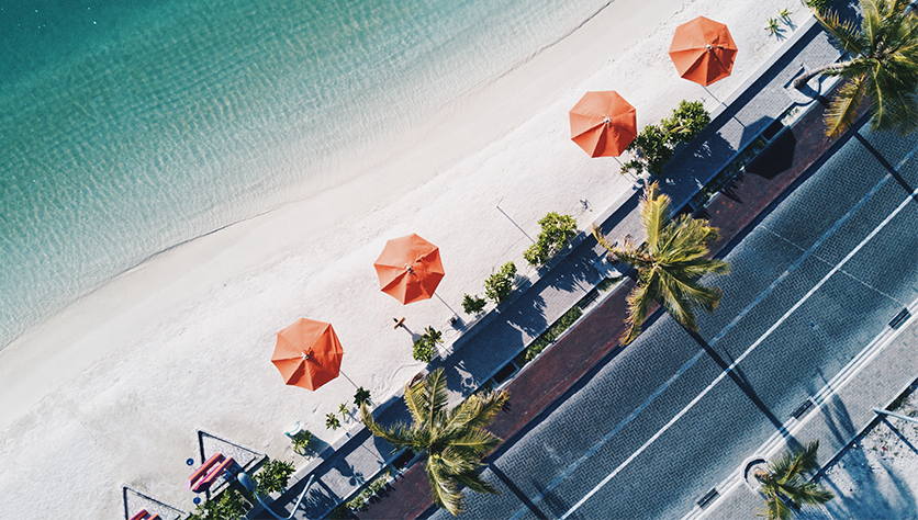 arial shot of beach with umbrellas